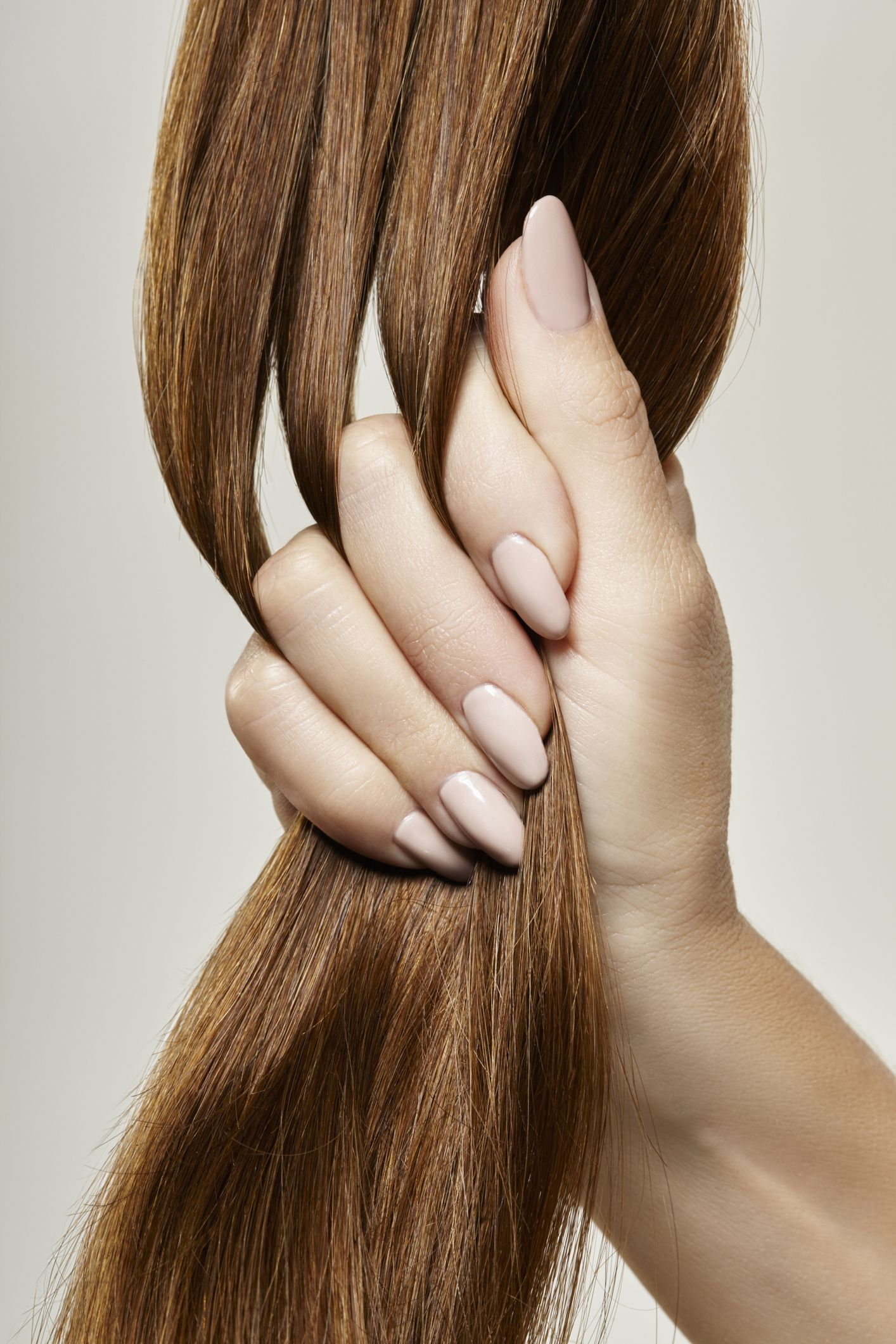 human-female-hand-holding-brown-hair-high-res-stock-photography-652974212-1565810706